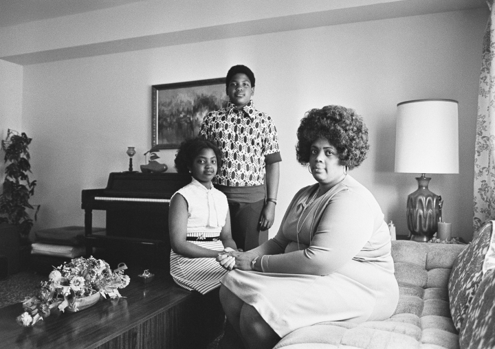 CORRECTS AGE TO 75, INSTEAD OF 76 - In this April 30, 1974, file photo, Linda Brown, right, and her two children pose for a photo in their home in Topeka, Kan. Brown, the Kansas girl at the center of the 1954 U.S. Supreme Court ruling that struck down racial segregation in schools, has died at age 75. Peaceful Rest Funeral Chapel of Topeka confirmed that Linda Brown died Sunday, March 25, 2018. (AP Photo/File)