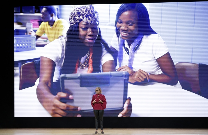 CORRECTS FROM KATHLEEN TO CATHLEEN - Apple's Cathleen Richardson, a former schoolteacher, speaks during an Apple event at Lane Technical College Prep High School, Tuesday, March 27, 2018, in Chicago. (AP Photo/Charles Rex Arbogast)