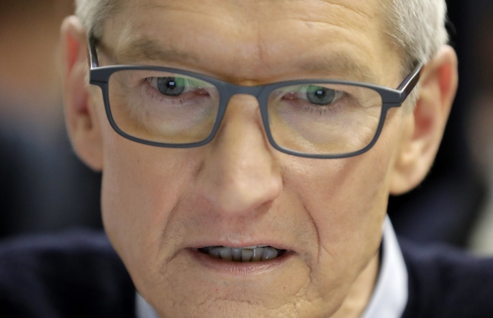 Apple CEO Tim Cook watches a demonstration of an app on the new educational Apple iPad during an Apple event at Lane Technical College Prep High School, Tuesday, March 27, 2018, in Chicago. (AP Photo/Charles Rex Arbogast)