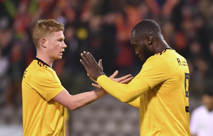 Belgium's Romelu Lukaku, right, is congratulated by Belgium's Kevin De Bruyne after scoring his sides first goal during an international friendly soccer match between Belgium and Saudi Arabia at King Baudouin stadium in Brussels on Tuesday, March 27, 2018. (AP Photo/Geert Vanden Wijngaert)