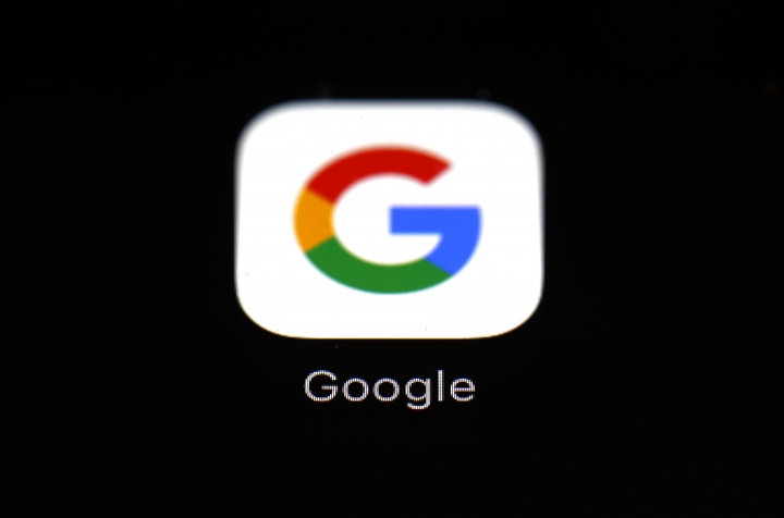 This March 19, 2018, photo shows the Google app on an iPad in Baltimore. On Tuesday, March 27, a federal appeals court overturned a decision in a long-running legal battle over whether Google infringed on Oracle's Java programming language to build its hugely popular mobile operating system, Android. (AP Photo/Patrick Semansky)