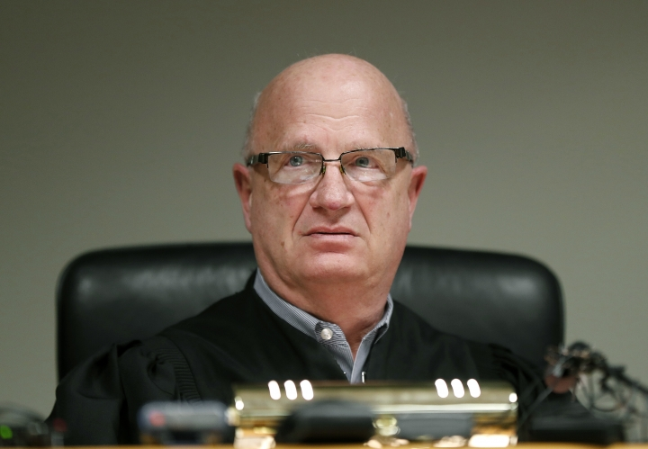 Judge Richard D. Ball listens to William Strampel during his video arraignment, Tuesday, March 27, 2018, in East Lansing, Mich. Strampel, a Michigan State University official who oversaw Larry Nassar, was arrested Monday amid an investigation into the handling of complaints against the former sport doctor, who is in prison for sexually assaulting patients under the guise of treatment. (AP Photo/Paul Sancya)