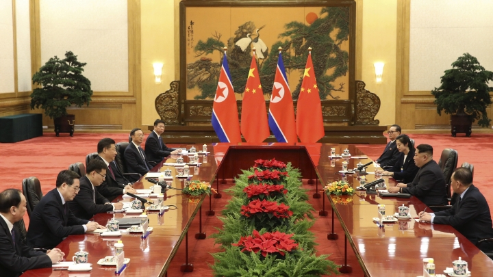 In this photo released Wednesday, March 28, 2018 by China's Xinhua News Agency, Chinese President Xi Jinping, fourth from left, and North Korean leader Kim Jong Un, second from right, meet at the Great Hall of the People in Beijing. The Chinese government confirmed Wednesday that North Korea's reclusive leader Kim went to Beijing and met with Chinese President Xi in his first known trip to a foreign country since he took power in 2011. (Yao Dawei/Xinhua via AP)