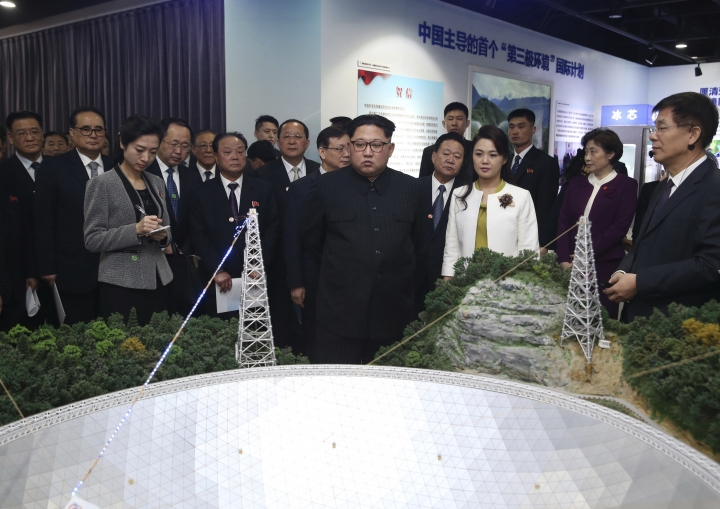 In this photo released Wednesday, March 28, 2018 by China's Xinhua News Agency, North Korean leader Kim Jong Un, center, and his wife Ri Sol Ju, visit an exhibition highlighting achievements by the Chinese Academy of Sciences. The Chinese government confirmed Wednesday that North Korea's reclusive leader Kim went to Beijing and met with Chinese President Xi Jinping in his first known trip to a foreign country since he took power in 2011. (Yao Dawei/Xinhua via AP)