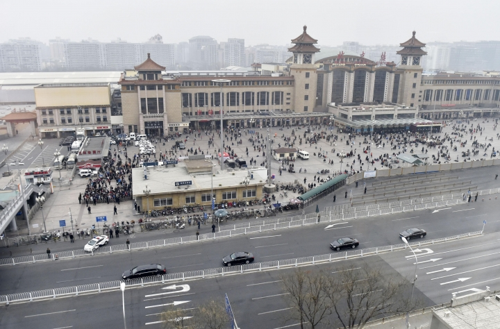 A motorcade, foreground, arrives at Beijing Railway Station in Beijing Tuesday, March 27, 2018. Speculation about a visit to Beijing by North Korean leader Kim Jong Un or another high-level Pyongyang official was running high Tuesday amid talk of preparations for a meeting between the North's reclusive leader and President Donald Trump. (Kyodo News via AP)