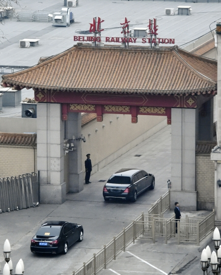 A motorcade arrives at Beijing Railway Station in Beijing Tuesday, March 27, 2018. Speculation about a visit to Beijing by North Korean leader Kim Jong Un or another high-level Pyongyang official was running high Tuesday amid talk of preparations for a meeting between the North's reclusive leader and President Donald Trump. (Kyodo News via AP)