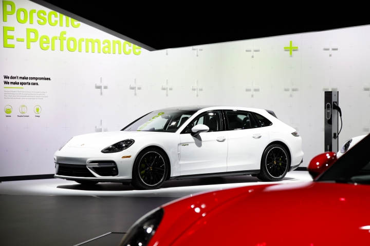 FILE- This Nov. 29, 2017, file photo shows the 2018 Porsche Panamera Turbo S E-Hybrid at the Los Angeles Auto Show in Los Angeles. Porsche goes from mild to wild in the six hybrid variants of the Panamera sedan. Topping the list is the Panamera Turbo S E-Hybrid that delivers a bruising 680 horsepower. (AP Photo/Jae C. Hong, File)