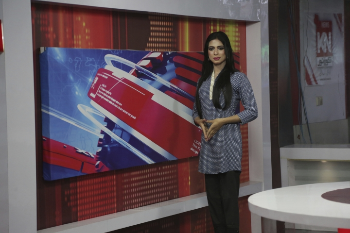In this photo taken on Tuesday, March 27, 2018, Pakistan's first transgender newscaster Marvia Malik poses for a photo in a control room of a local television channel in Lahore, Pakistan. Malik has made history in Pakistan by becoming the first transgender newscaster in a conservative Muslim country where her community is taunted in public, ostracized by family and targeted in violent attacks. (AP Photo/K.M. Chaudary)