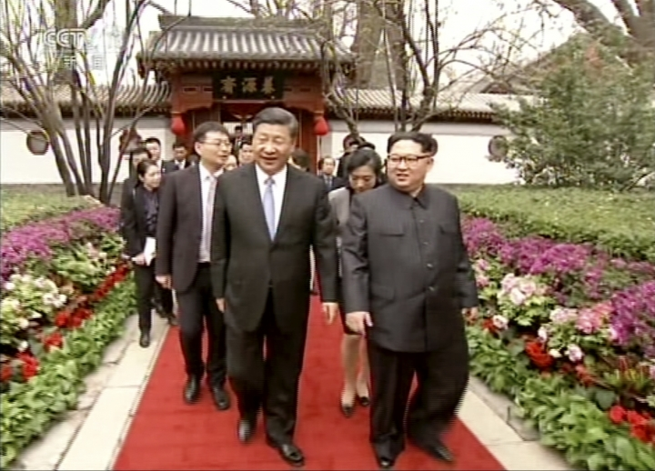In this image taken from video footage run Wednesday, March 28, 2018, by China's CCTV via AP Video, North Korean leader Kim Jong Un, right, and Chinese counterpart Xi Jinping, left, walk together in Beijing. North Korea's leader Kim and his Chinese counterpart Xi sought to portray strong ties between the neighbors and long-time allies despite a recent chill, as both countries on Wednesday confirmed Kim's secret trip to Beijing this week. (CCTV via AP Video)