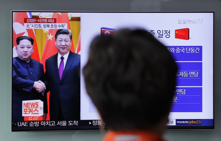 A woman watches a news program on TV reporting about the meeting between North Korean leader Kim Jong Un and Chinese President Xi Jinping at the Seoul Railway Station in Seoul, South Korea, Wednesday, March 28, 2018. North Korea's leader Kim and his Chinese counterpart Xi sought to portray strong ties between the neighbors and long-time allies despite a recent chill, as both countries on Wednesday confirmed Kim's secret trip to Beijing this week. (AP Photo/Lee Jin-man)
