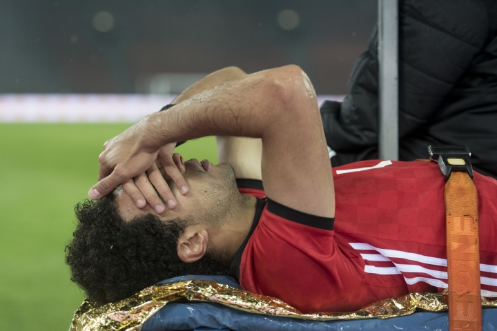 Egypt's Omar Gabber covers his face after being injured during the friendly soccer game Egypt against Greece at the Letzigrund stadium in Zurich, Switzerland, Tuesday, March 27, 2018. (Ennio Leanza/Keystone via AP)