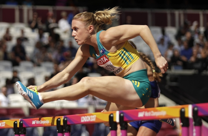 FILE - In this Aug.11, 2017, file photo, Australia's Sally Pearson competes in a women's 100m hurdles heat during the World Athletics Championships in London. More than 6,600 athletes and officials from across the world will converge on the Gold Coast for the 21st edition of the Commonwealth Games, the quadrennial multi-sports event for 71 countries and territories of the British Commonwealth. (AP Photo/Matt Dunham, File)