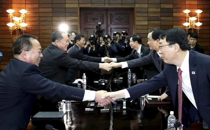 South Korean delegation led by Unification Minister Cho Myoung-gyon, second from right, and North Korean delegation led by Ri Son Gwon, second from left, shake hands after their meeting at the northern side of the Panmunjom Thursday, March 29, 2018. North Korean leader Kim Jong Un will meet South Korean President Moon Jae-in at a border village on April 27, the South announced Thursday after the nations agreed on a rare summit that could prove significant in global efforts to resolve a decades-long standoff over the North's nuclear program. (Korea Pool Photo via AP)