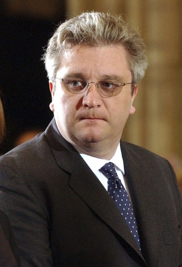 FILE - In this Sunday, April 3, 2005 file photo, Belgium's Prince Laurent, attends a memorial Mass for Pope John Paul II at the St. Michael church in Brussels. The Belgian parliament on Friday, March 30, 2018 has withdrawn part of the endowment of the ever-controversial Prince Laurent after he showed up at a Chinese diplomatic function in military uniform without the consent of the government. (AP Photo/Virginia Mayo, file)
