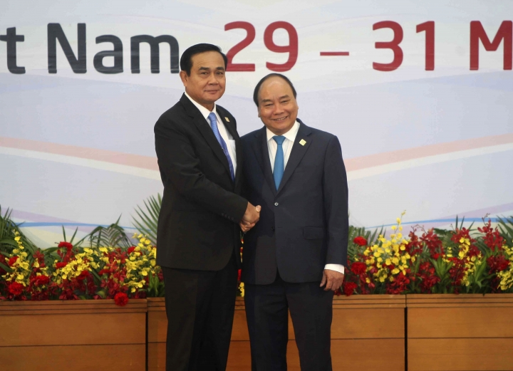 Vietnamese Prime Nguyen Xuan Phuc, right, and Thai Prime Minister Prayut Chan-o-cha pose for photographers ahead the Greater Mekong Summit in Hanoi, Vietnam, Saturday, March 31, 2018. (Vietnam News Agency via AP)