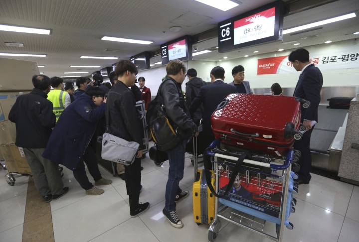 Members of South Korea's art troupe prepare to leave for North Korea at the Gimpo International Airport in Seoul, South Korea, Saturday, March 31, 2018. The South Korean artistic group including some of the country's biggest pop singers has departed for North Korea for rare performances highlighting the recent warming of ties between the war-separated rivals. (AP Photo/Ahn Youg-joon)