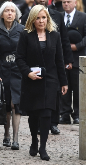 Professor Stephen Hawking's daughter Lucy attends the funeral of her father, at University Church of St Mary the Great in Cambridge, England, Saturday March 31, 2018. The renowned British physicist died peacefully at his Cambridge home on March 14 at the age of 76. (Joe Giddens/PA via AP)