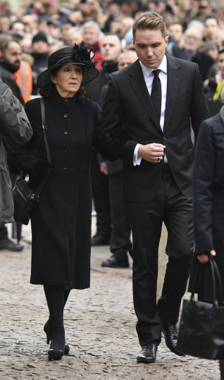 Jane Hawking, the first wife of Professor Stephen Hawking and their son Timothy, attend his funeral, at University Church of St Mary the Great in Cambridge, England, Saturday March 31, 2018. The renowned British physicist died peacefully at his Cambridge home on March 14 at the age of 76. (Joe Giddens/PA via AP)