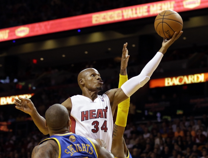 FILE - In this Jan. 2, 2014, file photo, Miami Heat's Ray Allen (34) shoots over Golden State Warriors' Marreese Speights during the first half of an NBA basketball game in Miami. Allen is among the 13-member class that will be inducted into the Basketball Hall of Fame in September, the Hall of Fame announced Saturday, March 31, 2018. (AP Photo/Lynne Sladky, File)