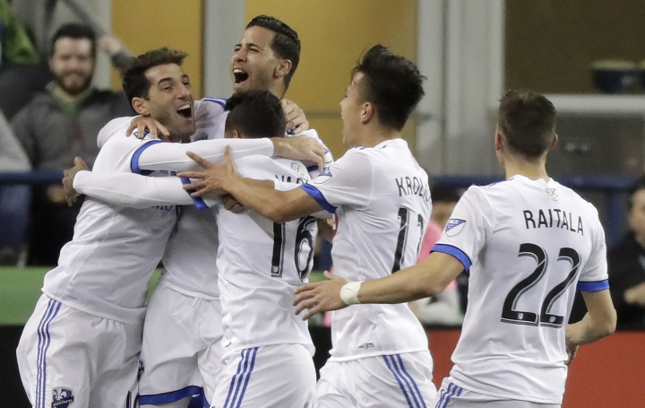 Montreal Impact forward Jeisson Vargas (16) celebrates with teammates after he scored a goal against the Seattle Sounders, during the second half of an MLS soccer match, Saturday, March 31, 2018, in Seattle. The Impact won 1-0. (AP Photo/Ted S. Warren)