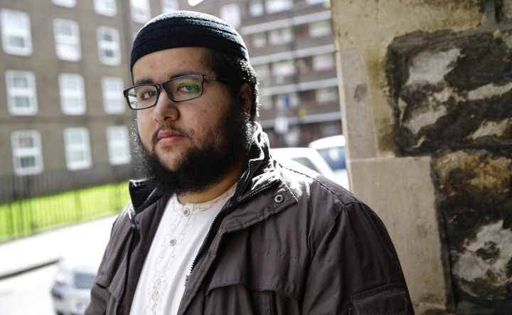 In this photo taken in Friday, March 23, 2018, Farooq, who declined to give his last name poses for a portrait outside a health surgery in London. To track down refugees in Britain who may have broken immigration rules, the government is controversially turning to the doctors who treat them for information, and Farooq said data sharing could make migrants nervous about getting medical attention. (AP Photo/Alastair Grant)