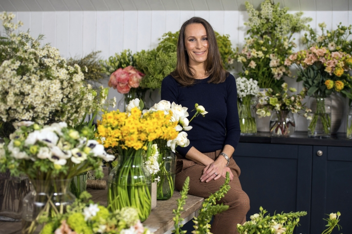 In this photo taken on Thursday, March 29, 2018, florist Philippa Craddock, poses for a photo, in her studio, in London. Britain's Prince Harry and Meghan Markle have chosen a self-taught London floral designer for their nuptials. The couple said Sunday, April 1, 2018 that Philippa Craddock will create the church flower arrangements for the May 19 wedding at St. George's Chapel in Windsor. (Dominic Lipinski/Pool Photo via AP)