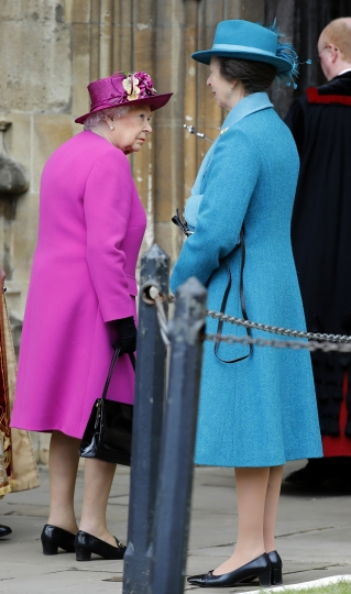 Britain's Queen Elizabeth II, left and Princess Anne arrive for the Easter Mattins Service at St. George's Chapel, Windsor Castle, in Windsor, England, Sunday, April 1, 2018. (Tolga Akmen/Pool Photo via AP)