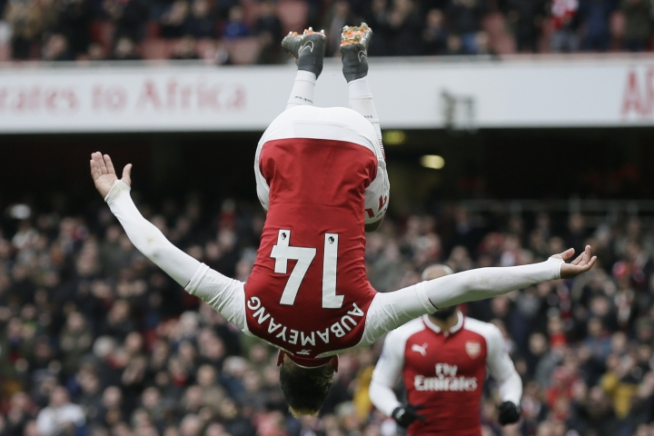 Arsenal's Pierre-Emerick Aubameyang celebrates after scoring a penalty during the English Premier League soccer match between Arsenal and Stoke City at the Emirates Stadium in London, Sunday, April 1, 2018. (AP Photo/Tim Ireland)
