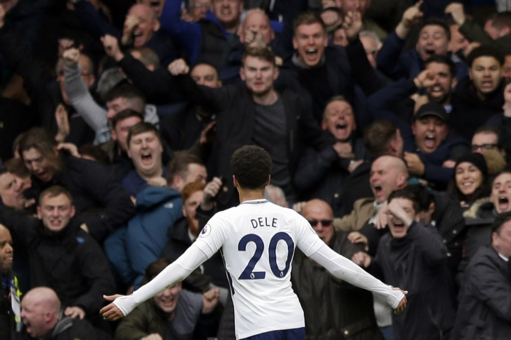 Tottenham's Dele Alli celebrates after scoring his side's third goal during the English Premier League soccer match between Chelsea and Tottenham Hotspur at Stamford Bridge stadium in London, Sunday, April 1, 2018. (AP Photo/Alastair Grant)