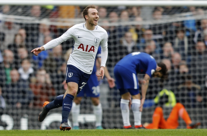 Tottenham's Christian Eriksen celebrates after scoring his side's first goal during the English Premier League soccer match between Chelsea and Tottenham Hotspur at Stamford Bridge stadium in London, Sunday, April 1, 2018. (AP Photo/Frank Augstein)