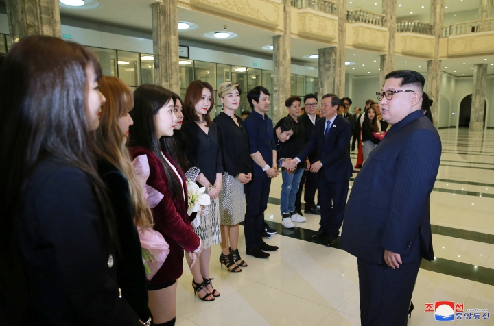 "In this photo provided by the North Korean government, North Korean leader Kim Jong Un, right, talks to members of the South Korean artistic group, including the South's pop legends and popular girl band Red Velvet, after their performance in East Pyongyang Grand Theater in Pyongyang, North Korea, Sunday, April 1, 2018. Kim clapped his hands as he, along with his wife and hundreds of other citizens, watched a rare performance Sunday by South Korean pop stars visiting Pyongyang, highlighting the thawing ties between the rivals after years of heightened tensions over the North's nuclear program. Independent journalists were not given access to cover the event depicted in this image distributed by the North Korean government. The content of this image is as provided and cannot be independently verified. Korean language watermark on image as provided by source reads: ""KCNA"" which is the abbreviation for Korean Central News Agency. (Korean Central News Agency/Korea News Service via AP)"