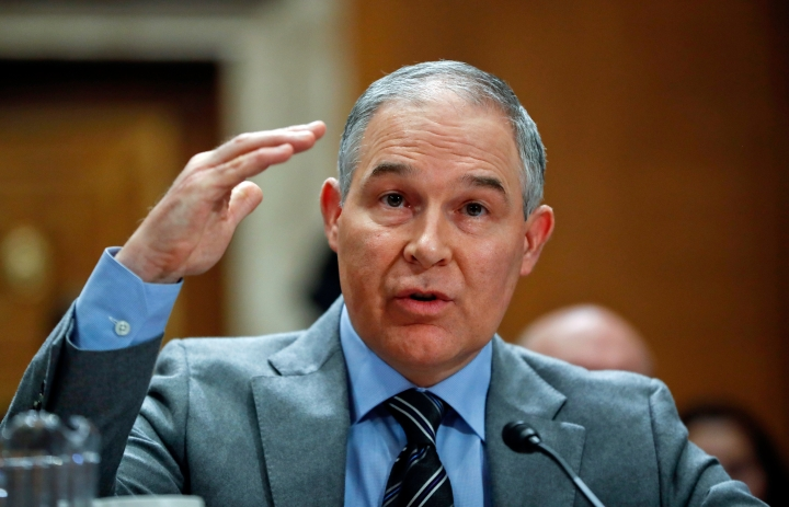"""FILE - In this Jan. 30, 2018, file photo, Environmental Protection Agency administrator Scott Pruitt testifies before the Senate Environment Committee on Capitol Hill in Washington. Environmental regulators announced on Monday, April 2, 2018, they will ease emissions standards for cars and trucks, saying that a timeline put in place by President Obama was not appropriate and set standards """"too high."""" Pruitt says the agency will work with all states, including California, to finalize new standards. (AP Photo/Pablo Martinez Monsivais, File)"""