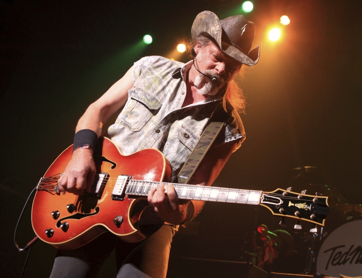 """FILE - In this Aug. 16, 2013 file photo shows Ted Nugent performs at Rams Head Live in Baltimore. Nugent says David Hogg, a survivor of the Parkland, Florida, school shooting massacre who has become an outspoken advocate for gun safety measures, is """"so brainwashed"""" he probably can't be fixed. (Photo by Owen Sweeney/Invision/AP, File)"""