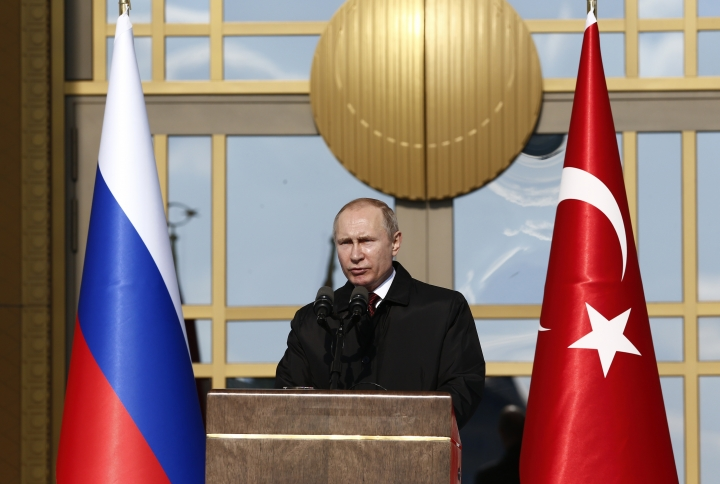 Russia's President Vladimir Putin talks during a welcome ceremony by Turkey's President Recep Tayyip Erdogan at the Presidential Palace, in Ankara, Turkey, Tuesday, April 3, 2018. (AP Photo/Burhan Ozbilici)
