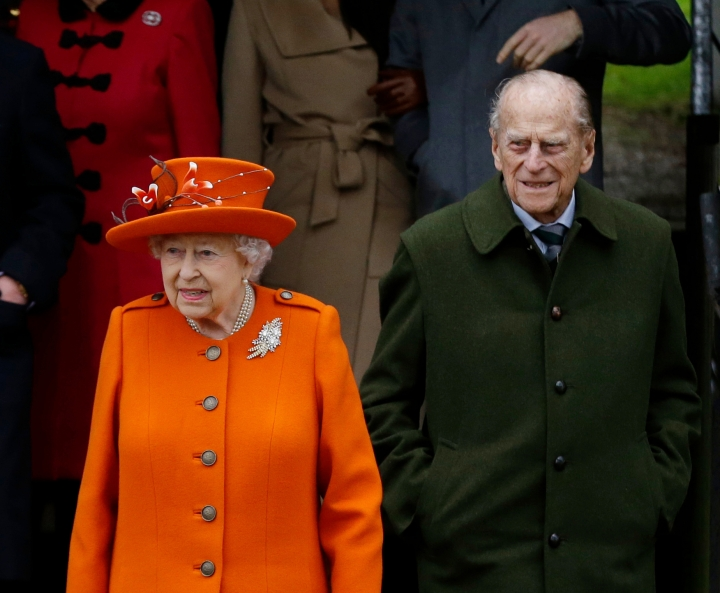 FILE - In this file photo dated Monday, Dec. 25, 2017, Britain's Queen Elizabeth II and Prince Philip, wait for their car following the traditional Christmas Day church service, at St. Mary Magdalene Church in Sandringham, England. Buckingham Palace said in a statement Tuesday April 3, 2018, that Queen Elizabeth's husband, Prince Philip, has been admitted to hospital for a previously scheduled hip surgery, that is expected to be carried out Wednesday. (AP Photo/Alastair Grant, FILE)