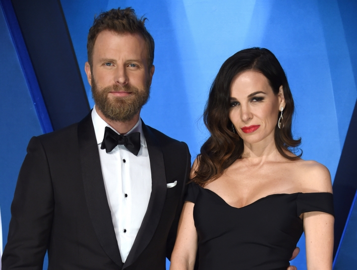 "FILE - In this Nov. 8, 2017 file photo, Dierks Bentley, left, and his wife Cassidy Black arrive at the 51st annual CMA Awards in Nashville, Tenn. Bentley hopes that his new single reminds people that he's not always singing about being drunk on a plane, or being a beach bum looking for a rebound. Bentley will perform his new song, ""Woman, Amen,"" at the Academy of Country Music Awards in Las Vegas on April 15. (Photo by Evan Agostini/Invision/AP, File)"