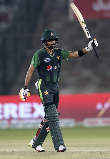 Pakistan's Babar Azam acknowledges his fifty against West Indies during the final of the Twenty20 match in Karachi, Pakistan, Tuesday, April 3, 2018. (AP Photo/Shakil Adil)