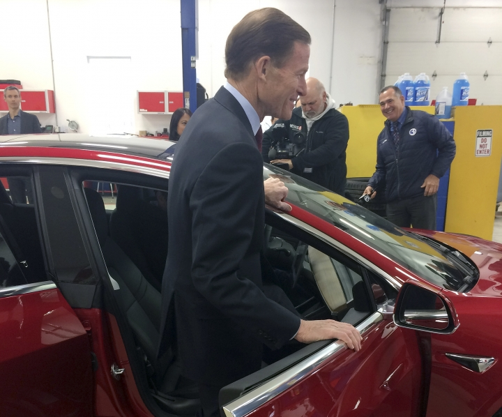 CORRECTS TO MODEL 3-U.S. Sen. Richard Blumenthal, D-Conn., climbs into a Tesla Model 3 at the Consumer Reports Test Track, Tuesday, April 3, 2018, in Colchester, Conn. The senator said he thinks more safeguards should be added to a bill that is before the Senate that would gradually introduce self-driving cars in the U.S. Among other things, he wants cars with autopilot systems like the Tesla, the same model involved in last month's fatal accident, to be included under the bill. (AP Photo/Susan Haigh)