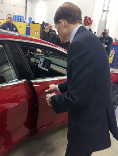 U.S. Sen. Richard Blumenthal, D-Conn., prepares to enter a Tesla Model 3 at the Consumer Reports Test Track, Tuesday, April 3, 2018, in Colchester, Conn. The senator said he thinks more safeguards should be added to a bill that is before the Senate that would gradually introduce self-driving cars in the U.S. Among other things, he wants cars with autopilot systems like the Tesla, the same model involved in last month's fatal accident, to be included under the bill. (AP Photo/Susan Haigh)