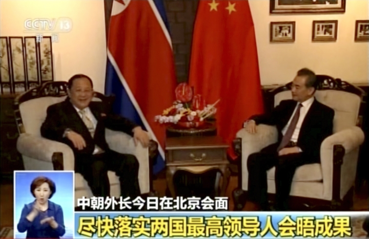 "In this image taken from video footage by China's CCTV via AP Video, Chinese State Councilor and Foreign Minister Wang Yi, right, talks to North Korea Foreign Minister Ri Yong Ho during their meeting in Beijing, Tuesday, April 3, 2018. Wang told North Korea's foreign minister on Tuesday that Beijing supports the North's planned summits with South Korea and the United States. The words at bottom read "" Implement the leaders of the two countries (the U.S. and North Korea) have achievement as soon as possible. (CCTV via AP Video)"