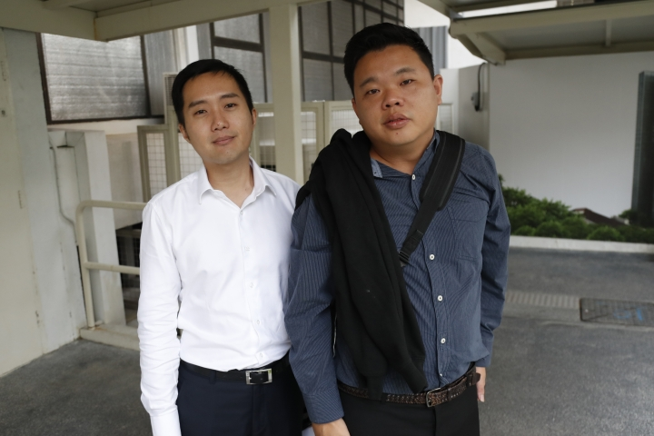 In this Tuesday, Jan. 16, 2018, photo, Terence Tan En Wei, 35, left, and Yao Songliang, 34, arrive at the State Court in Singapore. A court in Singapore on Tuesday fined two men 60,000 Singapore dollars ($45,800) each for breaching laws banning short-term rentals by renting out condominium units through online services such as Airbnb, Craigslist and HomeAway. The pair had pleaded guilty at the State Court in February to four charges of illegally renting out four units last year, in the first case of its kind in the Southeast Asian island nation. (AP Photo/Yong Teck Lim)