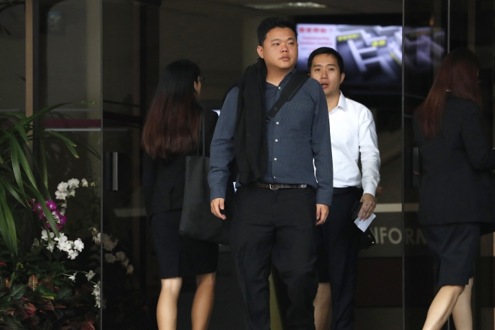 In this Jan. 16, 2018, photo, Terence Tan En Wei, 35, right, and Yao Songlaing, 34, leave the State Court in Singapore. A court in Singapore on Tuesday, April 3, 2018, fined two men 60,000 Singapore dollars ($45,800) each for breaching laws banning short-term rentals by renting out condominium units through online services such as Airbnb, Craigslist and HomeAway. The pair had pleaded guilty at the State Court in February to four charges of illegally renting out four units last year, in the first case of its kind in the Southeast Asian island nation. (AP Photo/Yong Teck Lim)