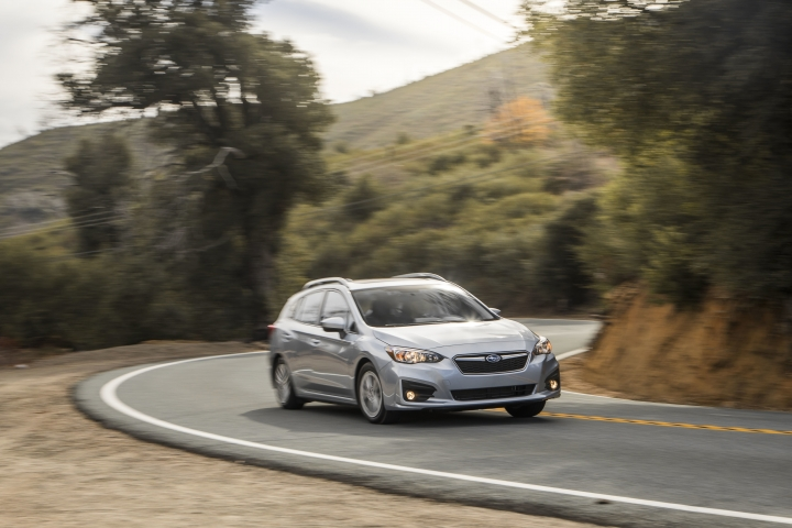 This undated photo provided by Subaru shows the 2018 Subaru Impreza five-door. This is a comfortable small car, and the hatchback model provides more rear headroom and cargo space than the Impreza sedan. (Subaru of America via AP)