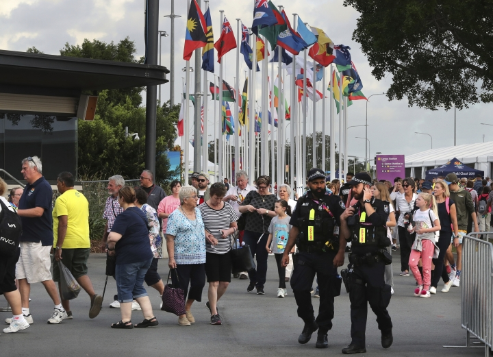 Police patrol at the Carrara Stadium as hundreds of people arrive to witness opening ceremony of the Commonwealth Games Gold Coast, Australia, Wednesday, April 4, 2018. The Commonwealth Games which begin Wednesday on the glitzy Gold Coast tourist strip involves 3,500 police and 2,000 members of the Australian Defense Force. (AP Photo/Manish Swarup)