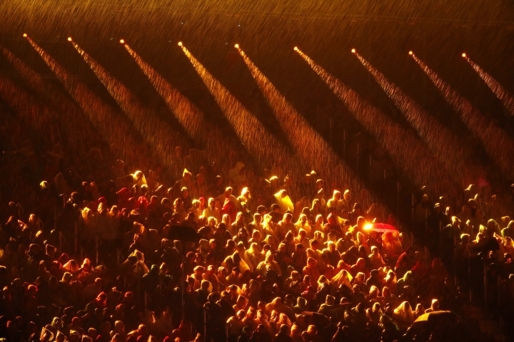 Lights illuminates rain at Carrara Stadium just before for the opening ceremony for the 2018 Commonwealth Games on the Gold Coast, Australia, Wednesday, April 4, 2018. (AP Photo/Mark Schiefelbein)