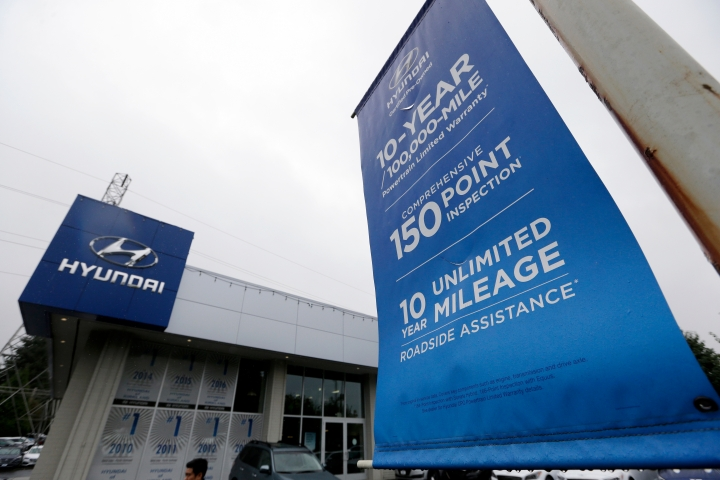 FILE- In this Oct. 12, 2017, file photo a Hyundai dealership includes a banner explaining used-car benefits in Kirkland, Wash. Used vehicle sales hit 39.2 million vehicles in 2017, more than double the number of new automobiles sold, according to the Edmunds.com auto website. (AP Photo/Elaine Thompson, File)
