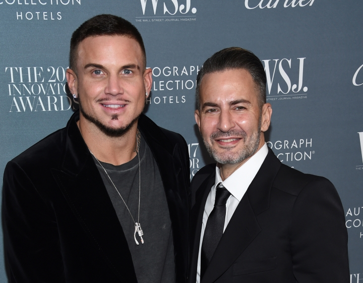"FILE - In this Nov. 1, 2017 file photo, Marc Jacobs, right, and Char Defrancesco attend the WSJ. Magazine Innovator Awards at The Museum of Modern Art in New York. In a video posted on Instagram, Wednesday, April 4, 2018, Jacobs dropped to his knee at a fast-food restaurant in New York City to pop the question to DeFrancesco after a flash mob danced to Prince's ""Kiss."" In the caption, Jacobs calls DeFrancesco his ""ride or die fiance."" (Photo by Evan Agostini/Invision/AP, File)"