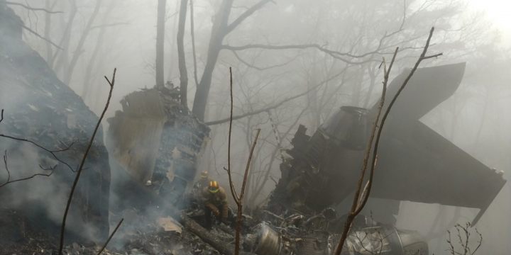 The wreckages of a crashed South Korea's air force F-15K fighter jet remain at a mountain in Chilgok, South Korea, Thursday, April 5, 2018. Two pilots were presumed dead after the South Korean F-15K fighter jet crashed Thursday at a mountain in the country's rural south, the air force said. (Kim Jun-beom/Yonhap via AP)