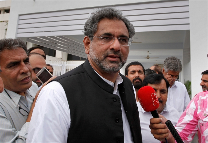 FILE - In this July 31, 2017 file photo, Pakistan's Prime Minister Shahid Khaqan Abbasi arrives at the Parliament in Islamabad, Pakistan. The foreign ministry says Abbasi will travel to the Afghan capital for a daylong visit on Friday, April 6, 2018 to discuss a range of issues, including how to facilitate talks between Kabul and the Taliban. (AP Photo/Anjum Naveed, File)
