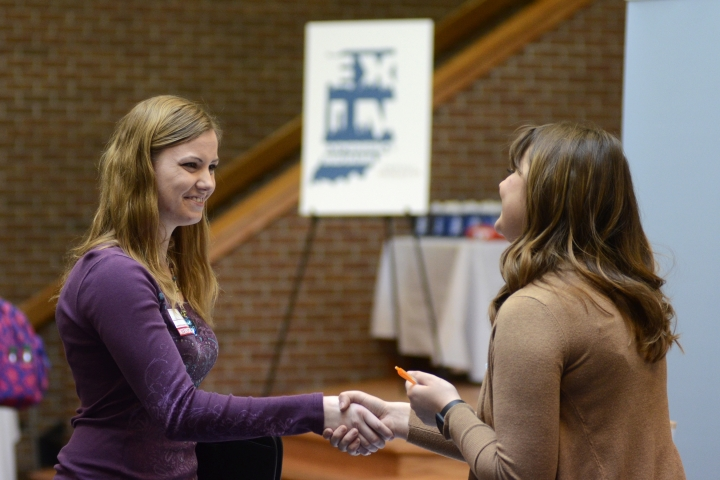 FILE- In this March 14, 2018, file photo, Indiana Wesleyan University senior Courtney Kingma, left, thanks Jennie Hehe, community resource manager for Tangram, for talking with her during the Experience Indiana job fair event in the student center at IWU in Marion, Ind. On Friday, April 6, the U.S. government issues the March jobs report. (Jeff Morehead/The Chronicle-Tribune via AP, File)